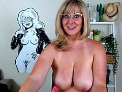 Blonde mature with big boobs masturbates in bed