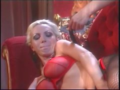 Nikki Benz in red lingerie giving a foot job to another hottie with a nice rack