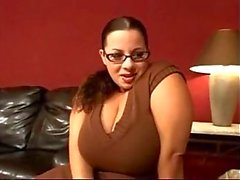 chubby brunette with glasses uses her big tits