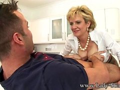 Lady Sonia Jerks Off Young Stud On Kitchen Counter