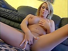 Sexy blonde with tattoos tries out her new dildo