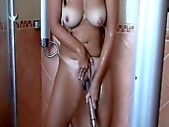 Tanned woman with big boobs pleases her aching snatch in th
