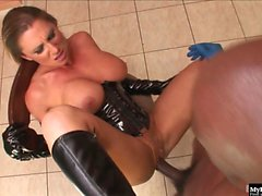 Blonde MILF with big boobs, Devon Lee, wearing a latex...