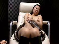 Charming Asian babe in pantyhose sends her fingers pleasing