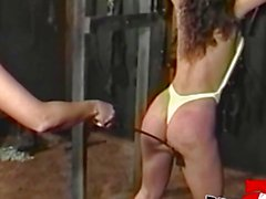 Hot lesbian Bambi Love in BDSM whipping session