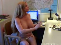 Nasty milf masturbates her wet warm pussy on office desk