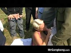 Busty Blonde In A Gang Bang Outdoors