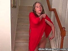 American milf Kelli strips off and masturbates on the stairs