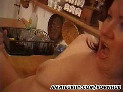 Busty amateur mom sucks and fucks in the kitchen