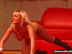 Blonde stripper toys her pussy on stage