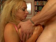 Horny blonde milf loves using her mega tits for the job