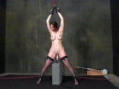 Dildo machine nails girl in bondage