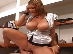 Giant boobs babe riding a dick in the office