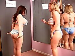 Two sluts with massive breasts get it on in the dressing room